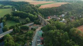 Aerial View of Old Bridge Viaduct in Green Wood Near The Village. Railroad Over Valley. stock footage