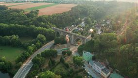 Aerial View of Old Bridge Viaduct in Green Wood Near The Village. Railroad Over Valley. stock video
