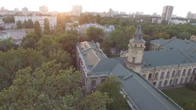 Aerial view of the old building of the university KPI in Kiev, Ukraine. The campus from bird's-eye view on the Sunset. 4k video. Top view stock footage