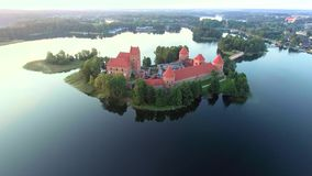 Aerial view of old castle on island stock footage