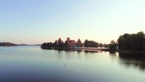 Aerial view of old castle on island. Aerial view of old castle on lake island stock footage