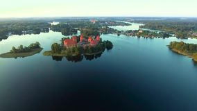 Aerial view of old castle on island stock video