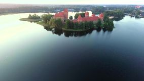 Aerial view of old castle on island stock video footage