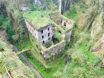 Aerial view of old castle overgrown with grass. Aerial view of old castle buildings in mountains overgrown with grass Stock Image
