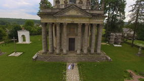 Aerial view of Old Catholic church with couple in love stock footage
