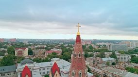 Aerial view of the old city and Christian cross on top of the spire of Odessa Lutheran St. Paul`s Cathedral