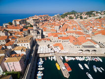 Aerial view of old city of Dubrovnik (Croatia) with old port in front. Stock Photos