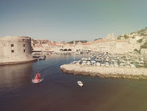 Aerial view of old city of Dubrovnik (Croatia) with old port in front. Stock Image