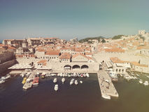 Aerial view of old city of Dubrovnik (Croatia) with old port in front. Royalty Free Stock Image