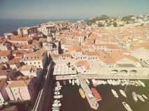 Aerial view of old city of Dubrovnik (Croatia) with old port in front. Stock Photography