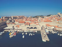 Aerial view of old city of Dubrovnik (Croatia) with old port in front. Stock Images