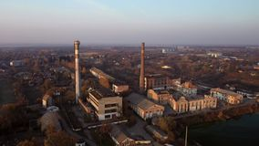Aerial view of an old factory ruin and broken windows. Old industrial building.
