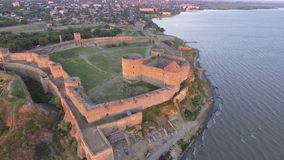 Aerial view of the Old fortress in Belgorod-Dniester at Sunrise, Ukraine.  stock footage