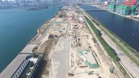Aerial view of old Hong Kong Kai Tak Airport runway become a construction site at 12 Decemeber 2016 stock footage