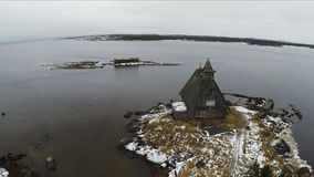 Aerial view of old house on winter coast stock video footage