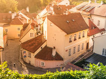 Aerial view of old medieval narrow cobbled street and small ancient houses of Novy Svet, Hradcany district, Prague Stock Images