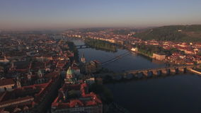 Aerial view of the old part of Prague and bridges over the Vltava river at sunrise. Charles bridge. Urban landscape. Aerial view of the old part of Prague and stock video footage