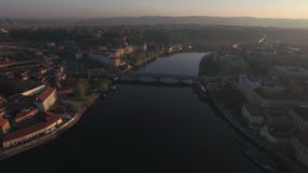 Aerial view of the old part of Prague and bridges over the Vltava river at sunrise. Charles bridge. Urban landscape stock video footage
