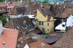 Aerial view of old town buildings in Sighisoara, Romania Royalty Free Stock Images