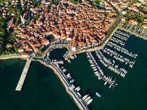 Aerial view of old town Izola in Slovenia, beautiful cityscape at sunset. Adriatic sea coast, peninsula of Istria, Europe. Aerial view of old town Izola in royalty free stock photo