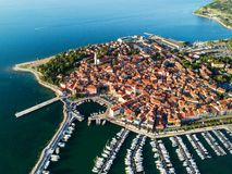 Aerial view of old town Izola in Slovenia, beautiful cityscape at sunset. Adriatic sea coast, peninsula of Istria, Europe. Aerial view of old town Izola in stock image