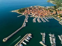Aerial view of old town Izola in Slovenia, beautiful seascape at sunset. Adriatic sea coast, peninsula of Istria, Europe royalty free stock image