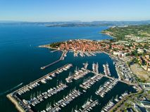 Aerial view of old town Izola in Slovenia, seascape with marina at sunset. Adriatic sea coast, peninsula of Istria, Europe. Aerial view of old town Izola in stock image
