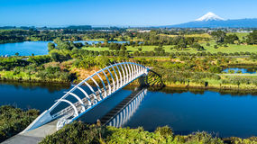 Free Aerial View On A Beautiful Bridge Across A Small Stream With Mount Taranaki On The Background. New Zealand Stock Photo - 97733670
