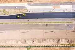 Free Aerial View On The New Asphalt Road Under Construction. Road Rollers Leveling New Asphalt Stock Images - 158813404