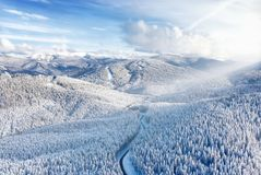 Free Aerial View On The Road And Forest At The Winter Time. Natural Winter Landscape From Air. Stock Photo - 137716140