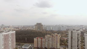 Aerial view of one of the districts of Moscow, cloudy and foggy weather. Urban cityscape from quadrocopter stock video footage