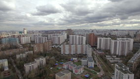 Aerial view of one of the districts of Moscow, cloudy weather. Urban cityscape from quadrocopter stock video footage