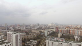 Aerial view of one of the districts of Moscow. Moscow state University and Moscow city in the distance. Urban cityscape stock footage