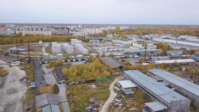 Aerial view of one Russian city`s industrial zone, hangars, plants and industrial equipment. Clip. Construction and. Aerial view of one Russian city`s industrial stock footage