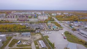 Aerial view of one Russian city`s industrial zone, hangars, plants and industrial equipment. Clip. Construction and. Aerial view of one Russian city`s industrial stock video