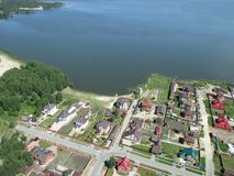 Aerial view onto private houses on bank of lake. Bird's eye view from helicopter onto rural street in Borovskiy village. Tyumen region. Russia Stock Photo