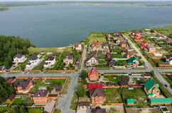 Aerial view onto private houses on bank of lake Stock Image