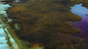 Aerial view of an open-cast mine. Toxic leaks out of Teghout tailing dam. An industrial waste disposal by copper and