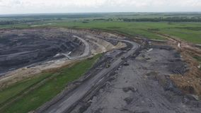Aerial view open method of mining of coal, anthracite, whales, quarry dump trucks stock footage