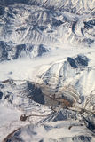 Aerial view of open-pit mine under snow, Chile Royalty Free Stock Images