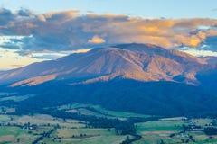 Aerial view of orange sunset light on beautiful mountain in Australian Alps. stock photo
