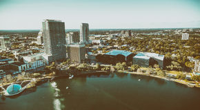 Aerial view of Orlando skyline along city lake on a sunny day, F stock photo