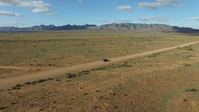 Aerial view of Outback Travelers on Dirt Road