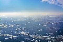 Aerial view over Arlanda airport in sunhaze. Sweden in February royalty free stock image