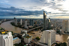 Aerial view over Bangkok modern office building in bangkok business zone near the river with sunset sky in Bangkok, Royalty Free Stock Images