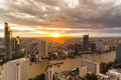 Aerial view over Bangkok modern office building in bangkok business zone near the river with sunset sky in Bangkok, Royalty Free Stock Image