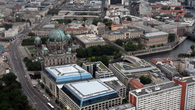 Aerial view over Berlin Cathedral from Fernsehturm. An aerial view over Berlin, cars passing by, Berlin Cathedral seen from the Berlin TV-tower stock video footage