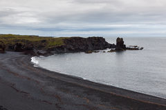 Aerial view over black beach in Snaefelsness. Aerial view over black beach in Snaefelsness peninsula, Iceland. Beautiful seashore landscape with low gray clouds Royalty Free Stock Photography