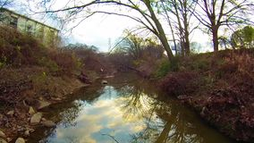 Aerial view over creek and water stock video footage