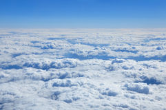Aerial view over the cumulus clouds. Stock Photos
